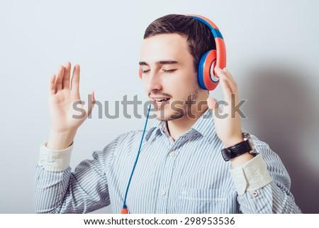 Cheerful guy enjoying loud music  - stock photo