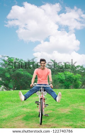 Cheerful guy taking a speedy ride down the hill - stock photo