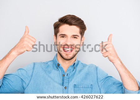 "Cheerful happy man gesturing ""LIKE"" with two hands"