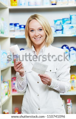 Cheerful happy pharmacist chemist woman working in pharmacy drugstore with doctor prescription - stock photo