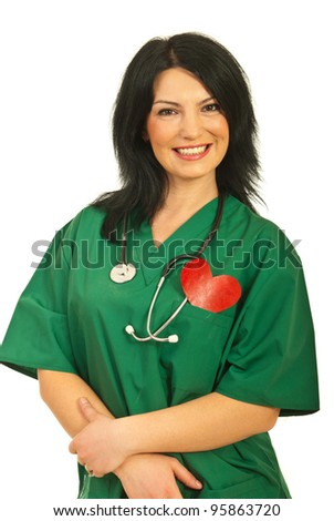 Cheerful health worker woman smiling and holding a heart shape in her pocket uniform isolated on white background