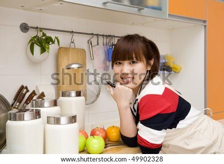 cheerful housewife - stock photo