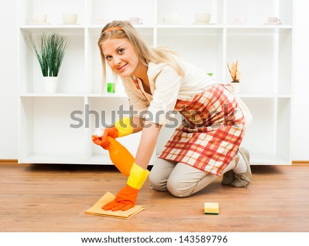 Cheerful housewife enjoys in cleaning,It`s time for cleaning - stock photo