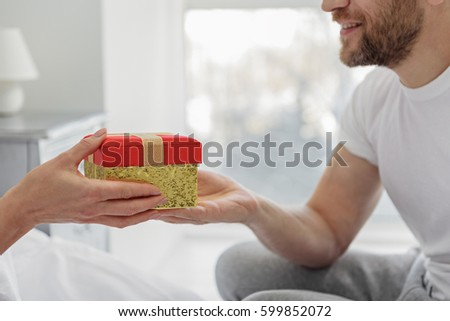 Cheerful husband presenting gift wife stock photo 599852072 cheerful husband presenting gift to wife negle Gallery
