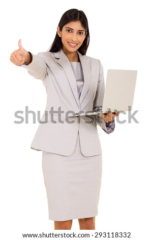 cheerful indian businesswoman holding laptop and giving thumb up - stock photo