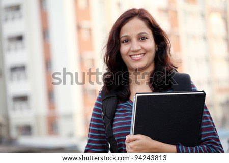 Cheerful Indian college student - stock photo