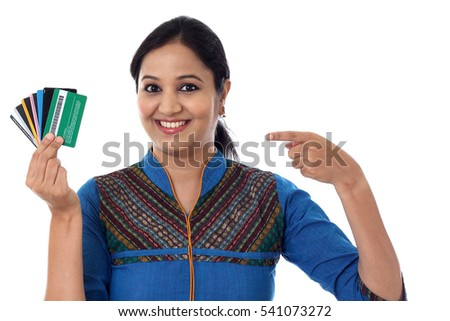 Cheerful Indian woman holding a bunch of debit cards-Cashless purchase concept