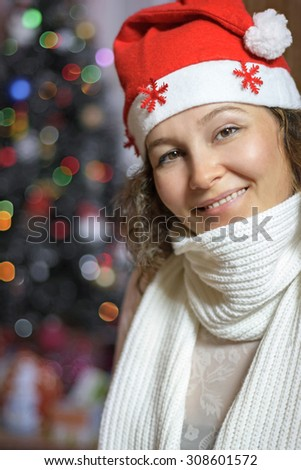 cheerful joyful girl in a Christmas hat - stock photo