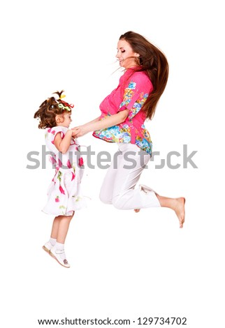 Cheerful jump of mother and daughter - stock photo