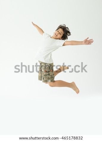 Cheerful kid jumping