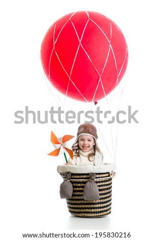 cheerful kid on hot air balloon - stock photo