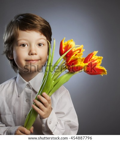 cheerful kid with a bouquet of tulips - stock photo