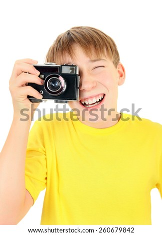 Cheerful Kid with Vintage Photo camera Isolated on the White Background - stock photo