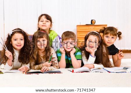 Cheerful kids crowd reading books - stock photo