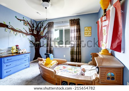 Cheerful kids room in light purple color with boat bed and murals - stock photo
