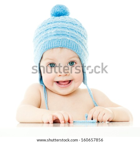 cheerful laughing baby in the hat. isolated. - stock photo