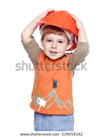cheerful little boy in an orange construction helmet.Isolated on white background. - stock photo