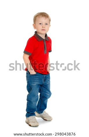 Cheerful little boy in the red sweater and jeans standing with his hands in his pockets-Isolated on white background - stock photo