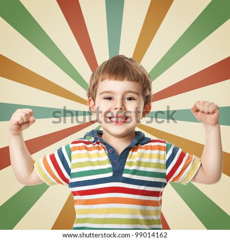 Cheerful little boy raised his hand up. Shooting in the studio