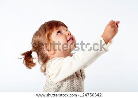 cheerful little girl asking something - stock photo