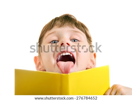 Cheerful Little Girl behind the Book Isolated on the White Background - stock photo
