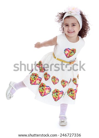 Cheerful little girl does swallow.Isolated on white background - stock photo