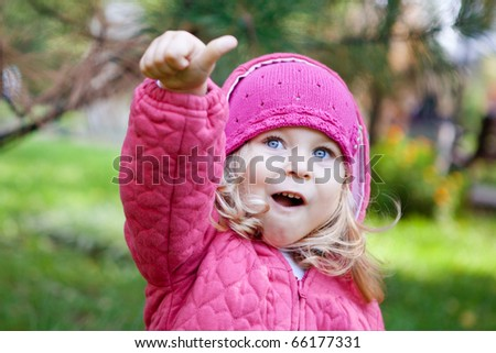 Cheerful little girl  dressed in pink - stock photo