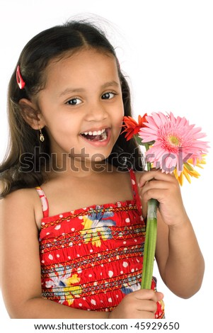 Cheerful little girl holding bunch of Gerabra flowers - stock photo