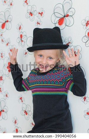 Cheerful little girl in a hat - stock photo