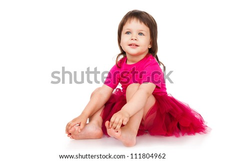Cheerful little girl in a red skirt