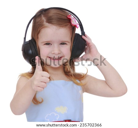 Cheerful little girl in big black headphones.White background, isolated photo. - stock photo