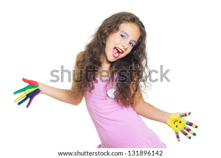 cheerful little girl is playing with colors - stock photo