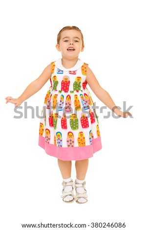 Cheerful little girl jumping - Isolated on white background - stock photo