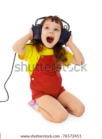 Cheerful little girl loudly sings the music isolated on white background - stock photo