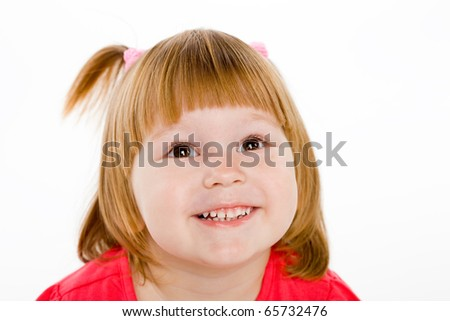 cheerful little girl on a light background.