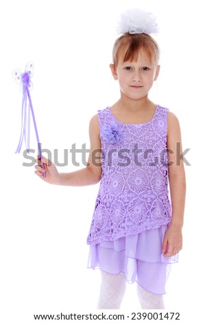 Cheerful little girl with a magic wand. Studio photo, isolated on white background. - stock photo