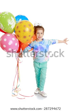 Cheerful little girl with bouncy balls in his hand-Isolated on white background - stock photo