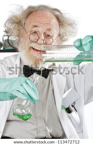 Cheerful mad senior scientist in lab measures green liquid in beaker. Closeup, frizzy grey hair, round glasses, lab coat, aqua rubber gloves, vertical, high key. - stock photo