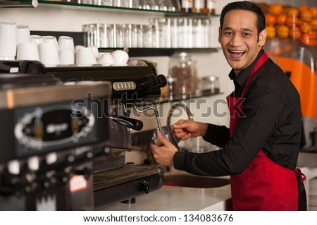 Cheerful male staff preparing customers order. - stock photo