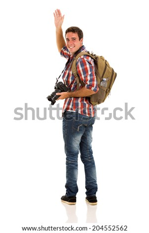 cheerful male tourist waving goodbye on white background - stock photo