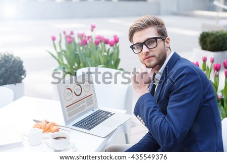 Cheerful male worker is relaxing in restaurant - stock photo