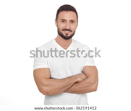 Cheerful man looking at camera - stock photo