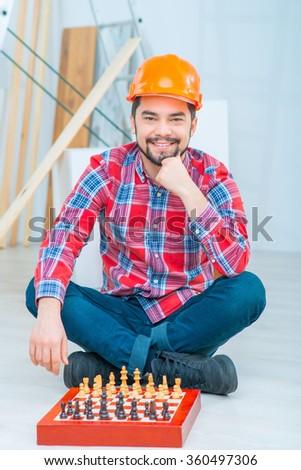 Cheerful man playing chess  - stock photo
