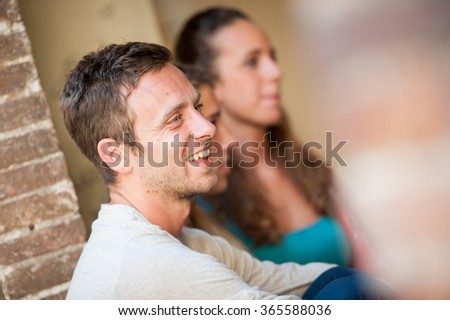 Cheerful man smiling on the city - stock photo