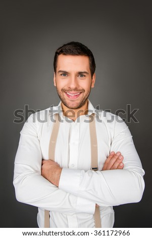Cheerful man with crossed hands - stock photo