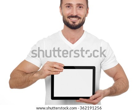 Cheerful man with digital tablet - stock photo