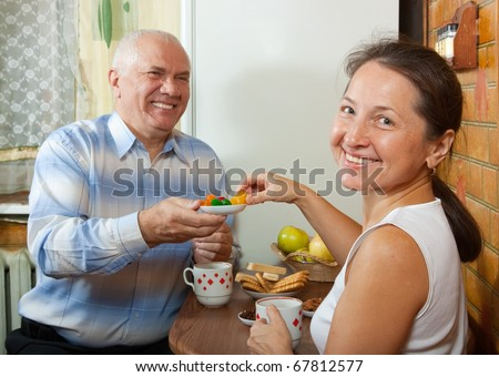 Cheerful mature couple enjoying a healthy breakfast at home