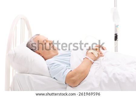 Cheerful mature patient lying in a hospital bed with an iv drip attached to his hand isolated on white background - stock photo
