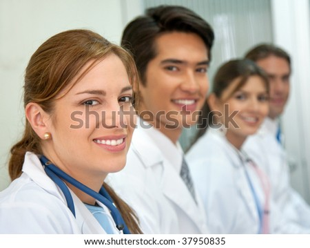 Cheerful medical team smiling at a hospital