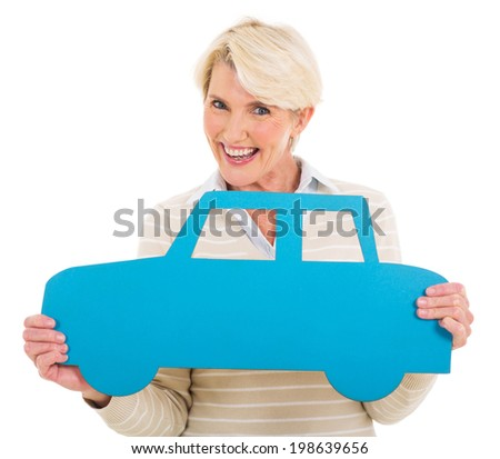 cheerful middle aged woman holding a car symbol on white background - stock photo